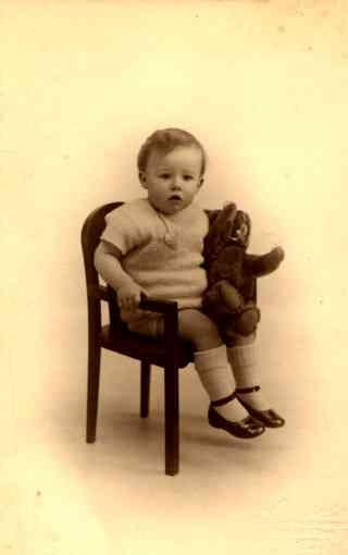 Boy Holding Teddy Bear in Chair RP