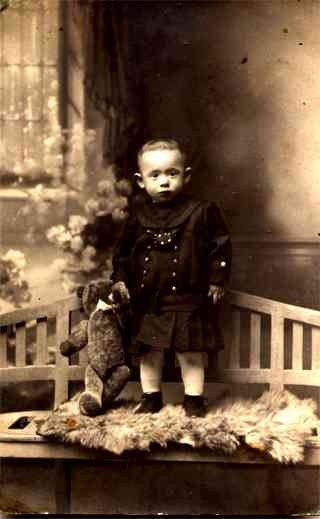 Girl Holding Teddy Bear on Bench RP