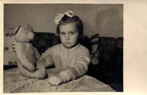 Girl Teddy Bear on Table RP