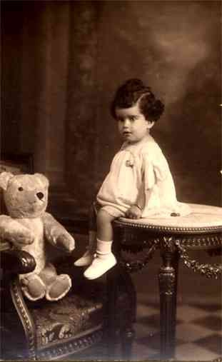 Teddy Bear in Arm Chair Girl on Table Real Photo