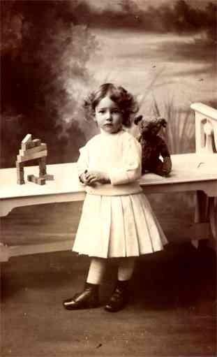 Teddy Bear on Table Hiding Behind Girl RP