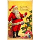 Santa Claus Baby Doll by Christmas Tree
