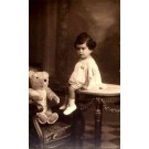 Teddy Bear in Arm Chair Girl on Table Real Photo