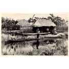 Seminole Indians in Canoe Everglades FL RP