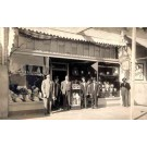 Salesmen by Clothes Storefront Real Photo