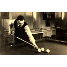 Player Holding Billiard Cue by Balls Real Photo