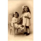 Girl in Chair Holding Teddy Bear Real Photo